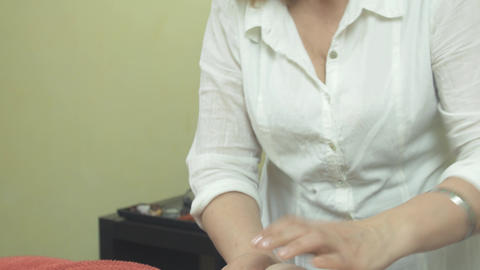 Masseuse make massage of fat stomach to adult woman in beauty saloon. Healthcare Footage