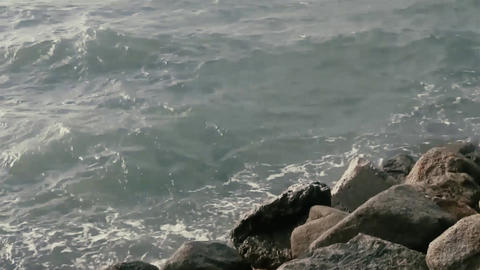 Waves incident on the rocky shore Footage