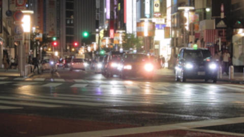 No sound:Tokyo at night, car which crosses traffic intersection in urban area Footage