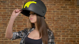 Young pretty attractive women looking into camera, raising her helmet and Footage