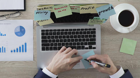 Businessman writing word idea on piece of paper, brainstorm and innovations Footage