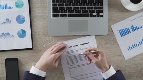 Applicant reading terms and conditions of employment contract, putting signature Footage