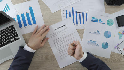 Businessperson signing business contract and shaking hands with partner, deal Live Action