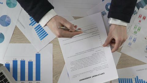 Male in suit signing employment agreement and giving it to manager, business Footage