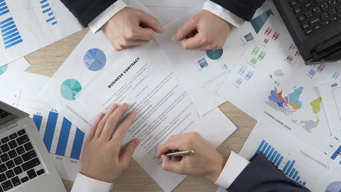 Company partner signing business contract and shaking hands with director Footage