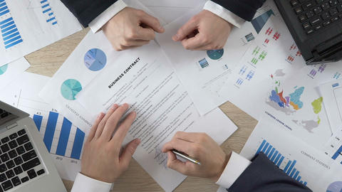 Top of view of businessperson signing business contract, men shaking hands Footage