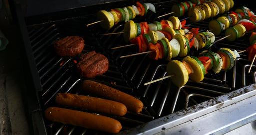Vegetables and vegan meat replacements cooking on a grill Footage