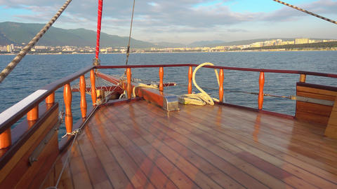 Beautiful sailing yacht floats to the port city Footage