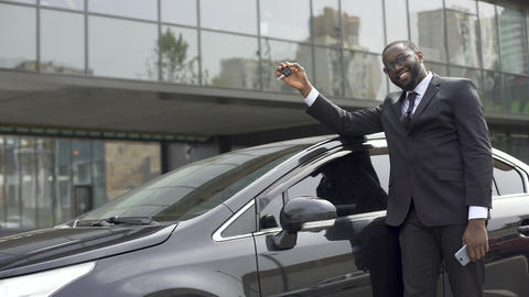 African-American man pleased that fulfilled his dream and bought luxury car Live Action