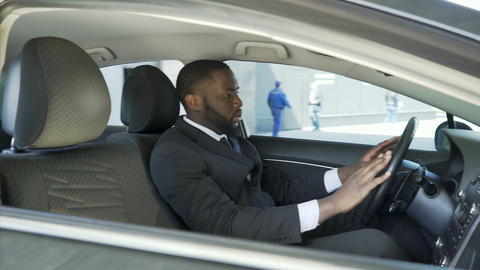Afro-American man getting angry and nervous because he cannot start the car Footage