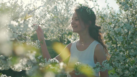 Young girl near beautiful flowering tree. Flowering... Stock Video Footage