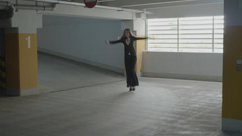 Young attractive businesswoman wearing formal suit jumping and funny dancing in Footage