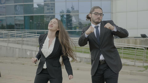 Attractive businesswoman and business man employees wearing formal clothes funny Live Action