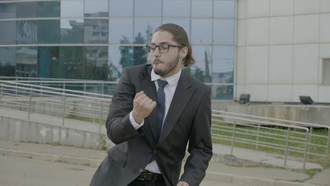 Happy young businessman in suit and tie wearing glasses funny dancing joyfully Footage