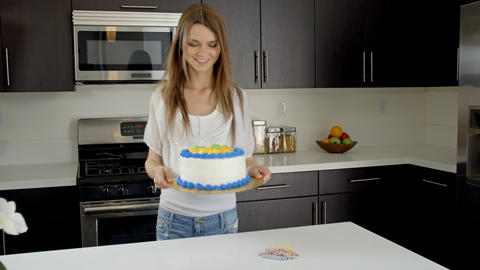 Attractive Woman Preparing A Birthday Cake GIF