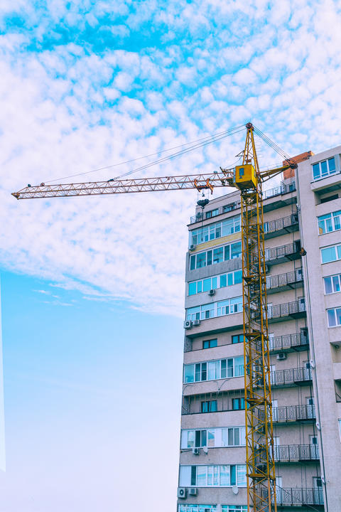 Construction crane against the building Photo