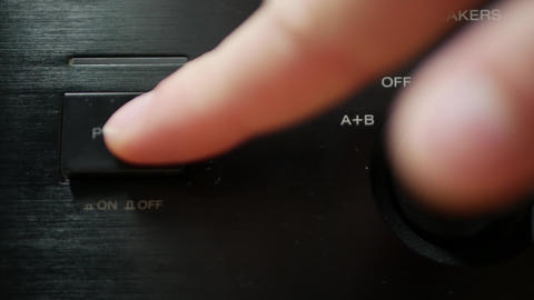 Turn on home audio amplifier receiver close-up Live Action