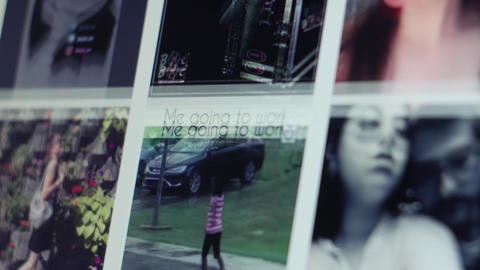 Browsing photos from Instagram social network on laptop display - close-up Live Action