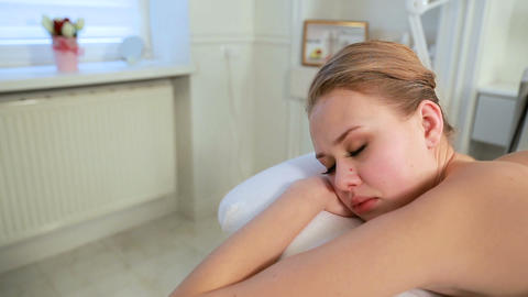 Perfect relaxation in spa salon. Young woman in a spa is relaxing. Thai massage Live Action