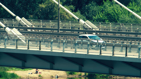 Unrecognizable modern compact car moving along the bridge Footage