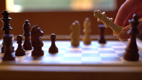 Chess game, check mate and surrendering the King, close up in natural window Footage