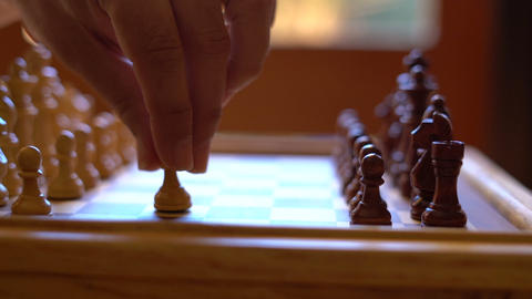 Chess game start, dolly slider, in natural window light, shallow DOF, slow Footage