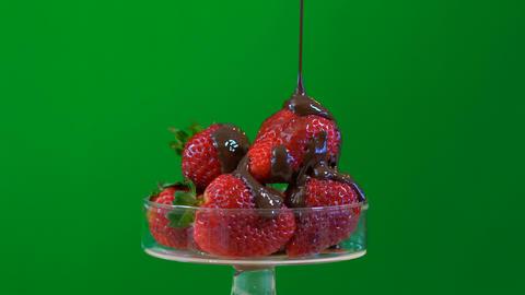 4k Green screen strawberries macro closeup in glass dish, pouring chocolate Footage