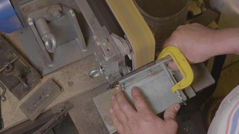 Sharpening knife blade on professional metalworking machine in workshop Footage