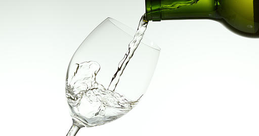White Wine being poured into Glass, against White Background, Slow motion 4K Footage