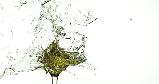 Glass of White Wine Breaking and Splashing against White Background, Slow motion 4K Live Action