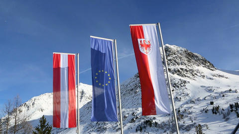 Three national flags at the border crossing in Austria Footage