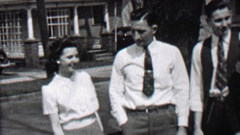 1939: Man gives women big hug for joining the family picture after all Footage