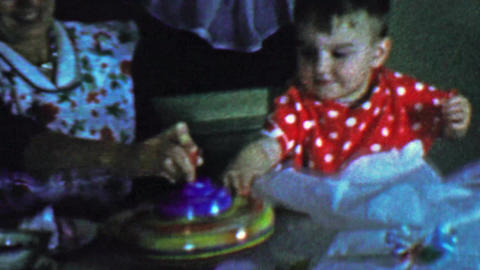 1957: Mom baby spinning top toy gift play learning centrifugal force Footage