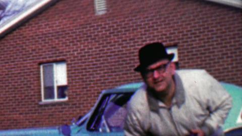 1958: Funny guy pranking camera man staring at hidden camera lens Footage