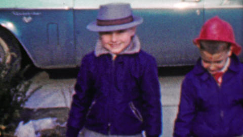 1958: Halloween trick or treating friends weather too cold heavy coats Footage