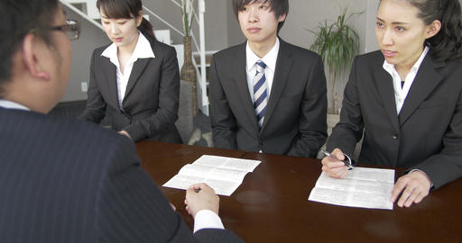 Business man Explains Contracts to job applicants Footage