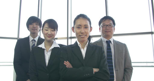 Confident Japanese business women backed up by her colleagues ビデオ