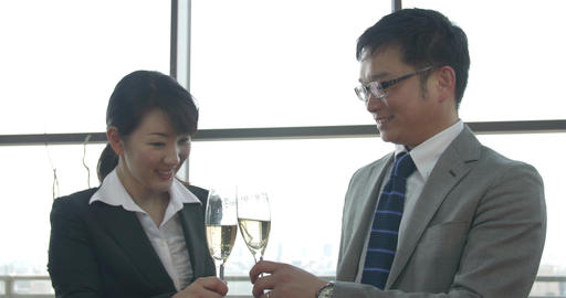 Japanese boss and subordinate celebrate success with a glass of champaign Footage