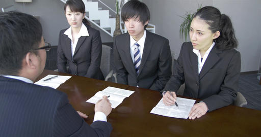 Japanese Boss explains the terms of contracts to new staffers Footage