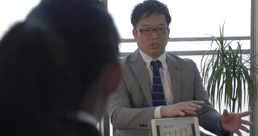 Japanese boss making a presentation to clients Footage
