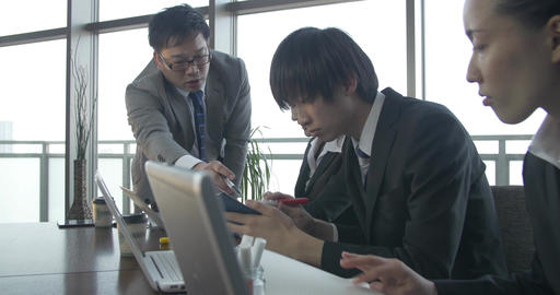 Japanese Business team work on a project together Footage