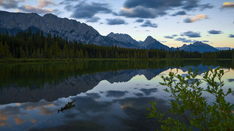 Dolly sunset time lapse over mountains at Spillway Lake in Kananaskis Country in Footage