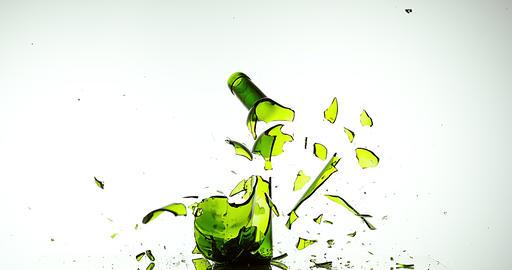Bottle of White Wine Breaking and Splashing against White Background, Slow motion 4K Footage