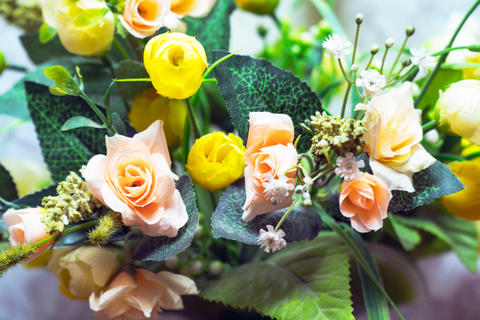 Bouquet of different artificial flowers フォト