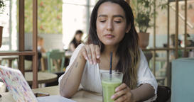 Young female drinking fresh smoothie Footage