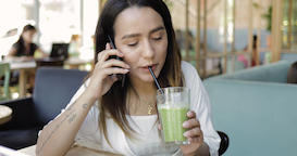 Young ethnic woman using mobile phone Footage