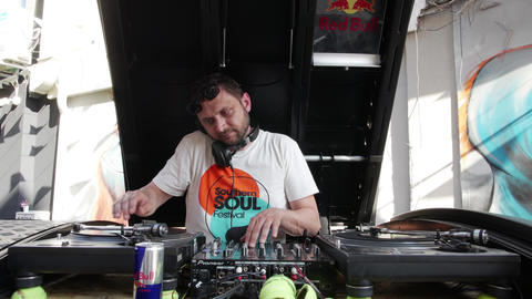 Dj scratching vinyl records on street festival Footage
