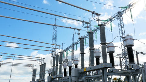 substation converts electrical energy under sunlight Live Action