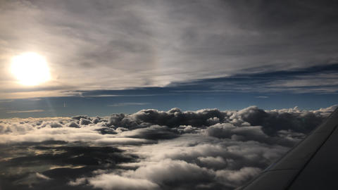 Incredible cloudscape as seen through airplane window Live Action