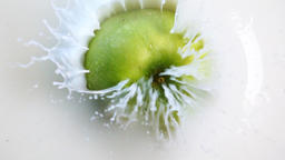Green apple fall into the milk Footage